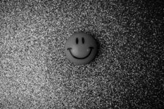 Emoji round plastic joyful smiling smiling toy round face on a b. Lack and white background royalty free stock image