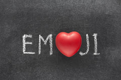 Emoji word heart. Emoji word handwritten on chalkboard with heart symbol instead of O stock photography