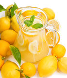 Emon juice in a jug and fruit with leaves Stock Photo