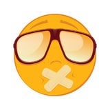 Emoticon with adhesive bandages over his lips in a sunglasses on white background. Stock Photo