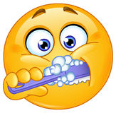 Emoticon brushing teeth Royalty Free Stock Photo