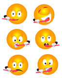 Emoticon brushing teeth Stock Photography