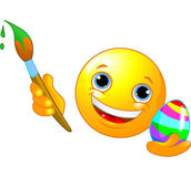 Emoticon che colora l'uovo di Pasqua Fotografia Stock