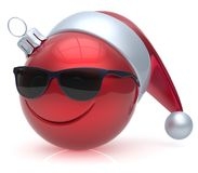 Emoticon Christmas ball eyeglasses smiley face adornment red. Emoticon Christmas ball eyeglasses smiley face adornment New Year`s Eve bauble cartoon decoration Stock Photography