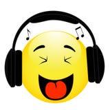 Emoticon con le cuffie su fondo bianco Fotografia Stock