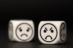 Emoticon dice with angry and sad expression sketch Royalty Free Stock Photography