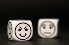 Emoticon dice with cunning and confused expression sketch Royalty Free Stock Image
