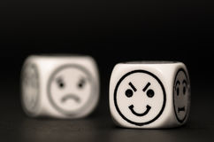 Emoticon dice with cunning and sad expression sketch Royalty Free Stock Photo