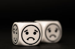 Emoticon dice with sad expression sketch Stock Photos