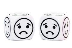 Emoticon dice with sad expression sketch Stock Photos