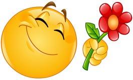 Emoticon die bloem geven royalty-vrije illustratie