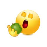Emoticon eating apple Stock Photo