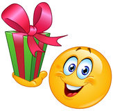 Emoticon with gift. Vector design of an emoticon with gift Royalty Free Stock Images