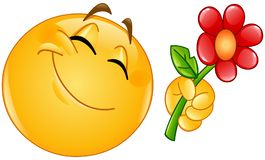 Emoticon Giving Flower Royalty Free Stock Photography