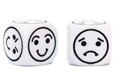 Emoticon kostka do gry z szczęśliwym i smutnym wyrażeniowym nakreśleniem Zdjęcia Royalty Free