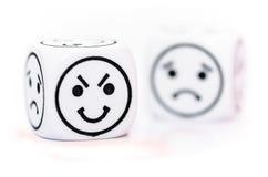 Emoticon kostka do gry z szczęśliwym i smutnym wyrażeniowym nakreśleniem Obraz Stock