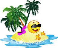 Emoticon lies on a beach Stock Image