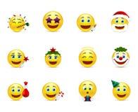 Emoticon luminosi con gli attributi di festa Immagini Stock