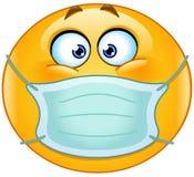 Emoticon med den medicinska maskeringen Fotografering för Bildbyråer