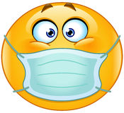 Emoticon with medical mask Stock Image
