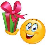 Emoticon met gift vector illustratie
