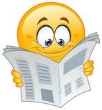 Emoticon mit Zeitung Stockfotos