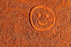 Emoticon nella sabbia Fotografia Stock