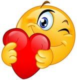 Emoticon que abraça o coração imagens de stock royalty free