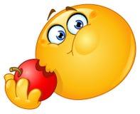 Emoticon que come la manzana ilustración del vector