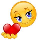 Emoticon que da el corazón Imagen de archivo