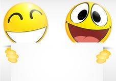 Emoticon que lleva a cabo una muestra de papel Imagen de archivo libre de regalías
