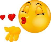 Emoticon redondo de la cara de la historieta que se besa que hace beso del aire Fotos de archivo libres de regalías