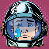 Emoticon sadness tears Emoji face man astronaut retro. Pop art retro style. Emotions face. Vector emoticon Stock Images