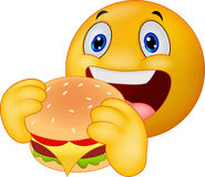 Emoticon smiley eating hamburger Stock Images