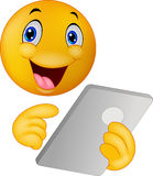 Emoticon smiley using tablet Royalty Free Stock Photography