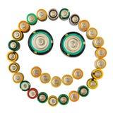 Emoticon sonriente hecho de las baterías aisladas Fotografía de archivo