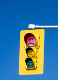 Emoticon Traffic Light. A traffic light with emoticon style faces. Smiley, sad and emotionless Stock Image