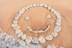 Emoticon of white pebbles Royalty Free Stock Images