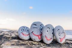 Emoticons en los guijarros Imagen de archivo libre de regalías