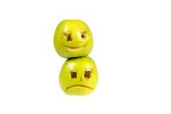 Emoticons felices y tristes de manzanas Sensaciones, actitudes Imágenes de archivo libres de regalías