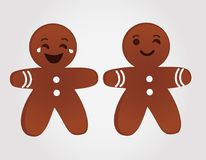 Emoticons gingerbread men smiling and winking Stock Image