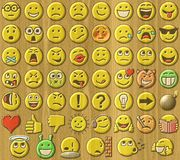 Emoticons relief painting on generated wood background Stock Photo