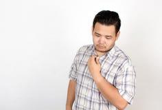 Emotie van de Aziatische vette mens Stock Foto