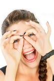 Emoties op het gezicht van een meisje met twee vlechten Royalty-vrije Stock Fotografie