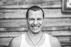 Emotion black and white portrait of man. film grain effect Stock Photos
