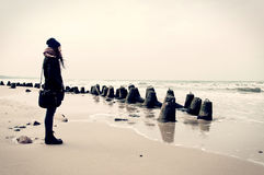 Emotion conceptual image. Sad lonely woman on the beach. Instagram vintage picture Stock Image