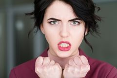 Emotion face furious angry woman rage teeth. Emotion face. furious angry woman in rage baring the teeth. young beautiful brunette girl portrait stock image