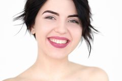 Emotion face happy smiling joyful delighted woman. Emotion face. happy smiling joyful delighted woman young beautiful brunette girl portrait on white background Stock Photos