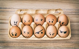 Emotion face painted eggs in paper box Royalty Free Stock Image