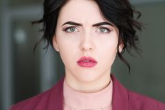 Emotion face sad upset serious sullen woman royalty free stock photography